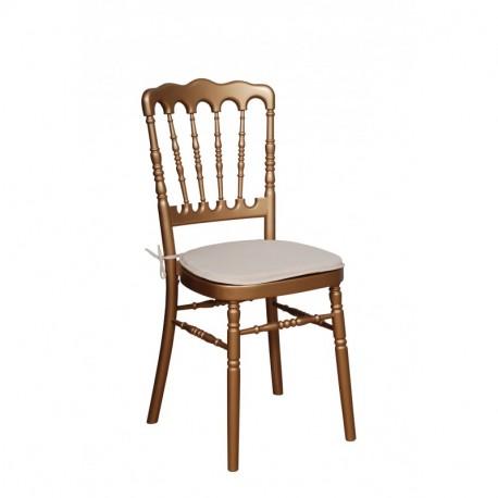 Chaise napoleon dorée et galette blanche