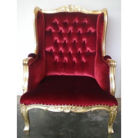 Location fauteuil à oreilles doré et velours rouge